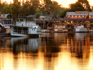 Sunset at Echuca Wharf with paddle steamers moored. Photo used to illustrate copyright Australia and watermarks