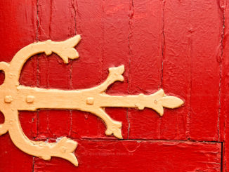 Close-up detail of old red door as part of an Excitations Photo Adventures workshop entitle Photography as Therapy.