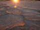 Sun setting ov cracked and dry salt encrusted lake bed. Photo By Excitations Photo Adventures workshops and training in regional Australia.