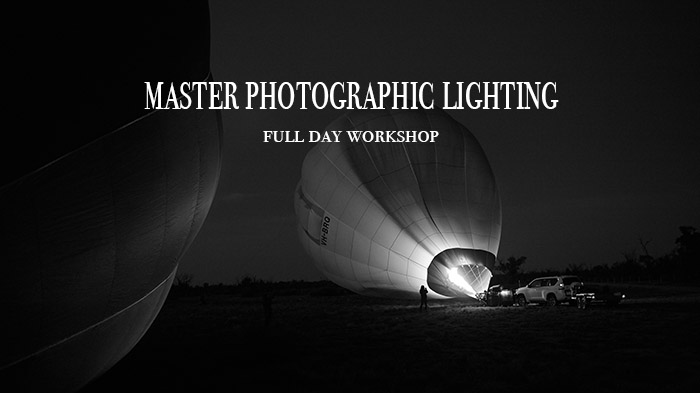 Black and white prom picture for Photo Adventures master photographic lighting workshop. Image is of a balloon being inflated at dawn.
