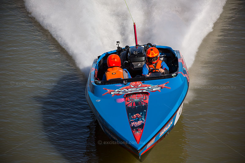 Blue race boat illustrating an blog post on selling stock photos by Excitations Photo Adventures and tours.