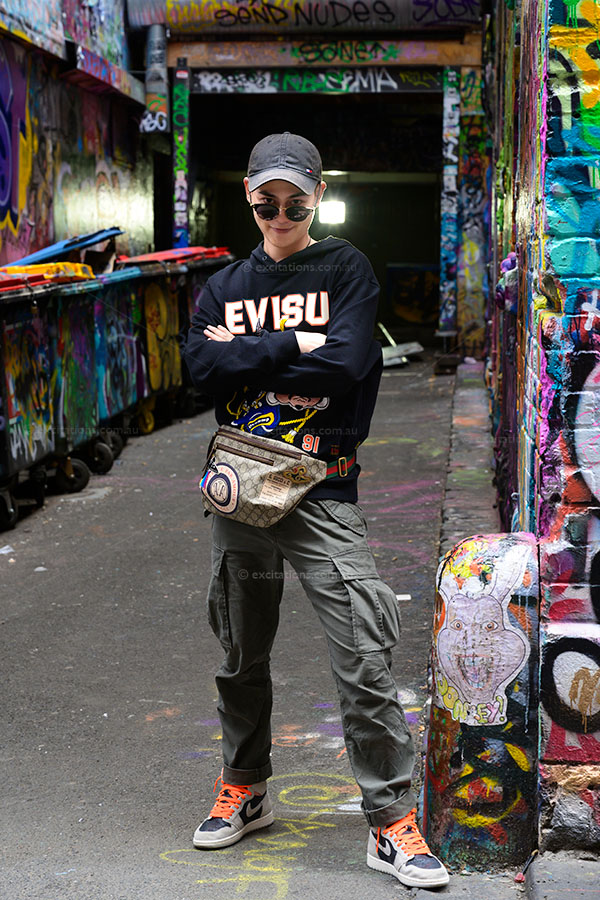Young urban man, surrounded by graffiti covered walls, Melbourne Australia. Excitations Photo Adventures and  photography workshops all over Australia.