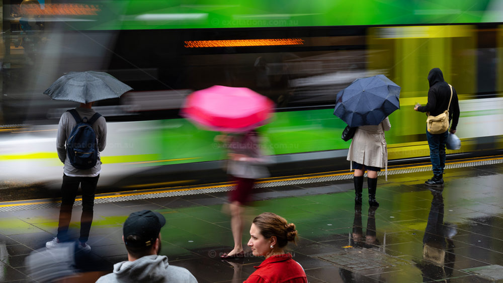 Motion blur semi-abstract photograph of commuters in Melbourne Australia waiting for a tram. Photo for Excitations Photo Adventures in Australia.