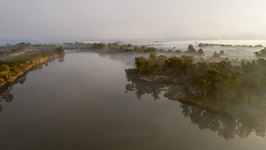Low altitude aerial stock photo of Murray River shrouded in fog, near Mildura.